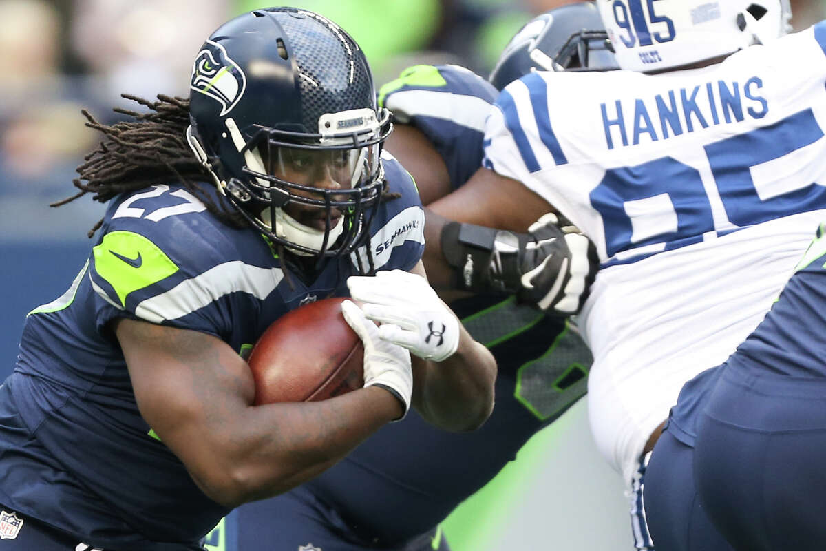 Seahawks running back Eddie Lacy looks for a hole during the first half against the Indianapolis Colts at CenturyLink Field on Saturday, Oct. 1, 2017.