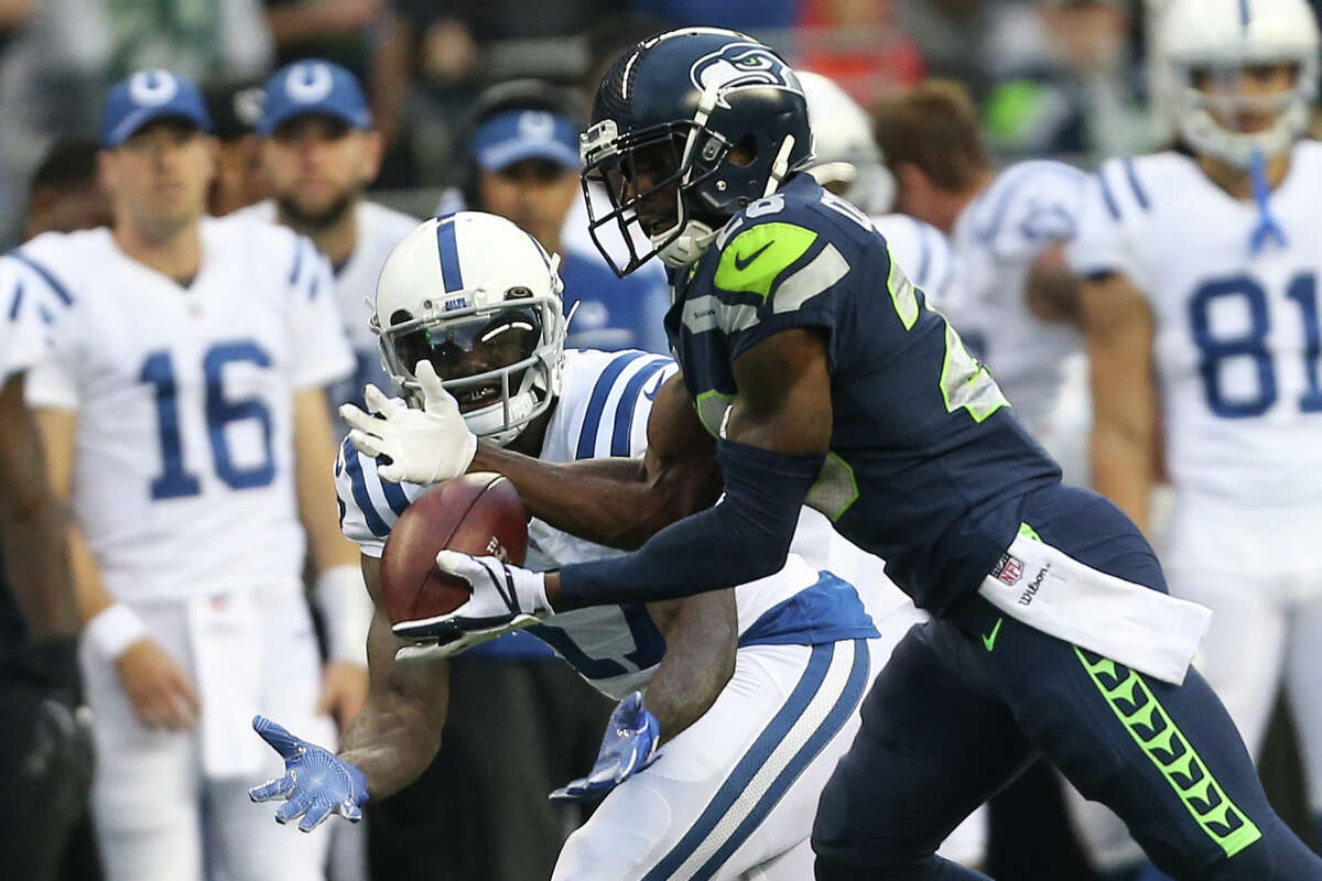 Seahawks corner back Justin Coleman intercepts a pass meant for Colts wide receiver Kamar Aiken during the first half against the Indianapolis Colts at CenturyLink Field on Saturday, Oct. 1, 2017. Coleman ran the ball in for a touchdown.