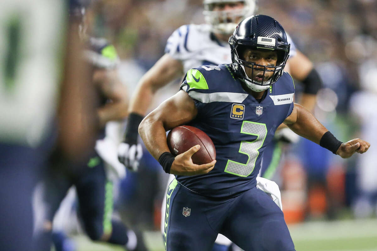 Seahawks quarterback Russell Wilson runs in for a touchdown during the second half against the Indianapolis Colts at CenturyLink Field on Saturday, Oct. 1, 2017.