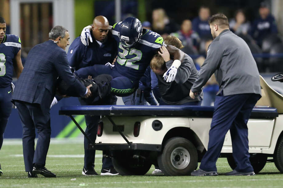 Seahawks running back Chris Carson is carted off the field after a left leg injury in the fourth quarter against the Indianapolis Colts at CenturyLink Field on Saturday, Oct. 1, 2017. Photo: GRANT HINDSLEY, SEATTLEPI.COM / SEATTLEPI.COM