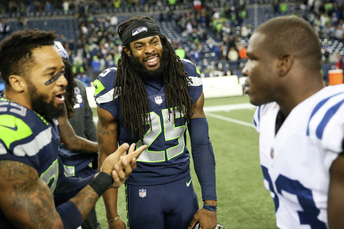 Seahawks corner back Richard Sherman and safety Earl Thomas greet Colts running back Frank Gore following the Seahawks 46-18 win at CenturyLink Field on Saturday, Oct. 1, 2017.