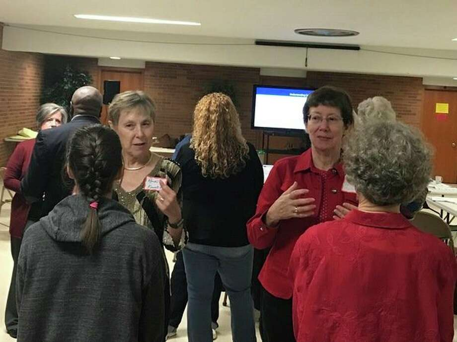 About 30 people gather in thebasement of First United Methodist Church of Midland on Friday, Sept. 29 to learn conflict resolution skills. (Kate Carlson/kcarlson@mdn.net)