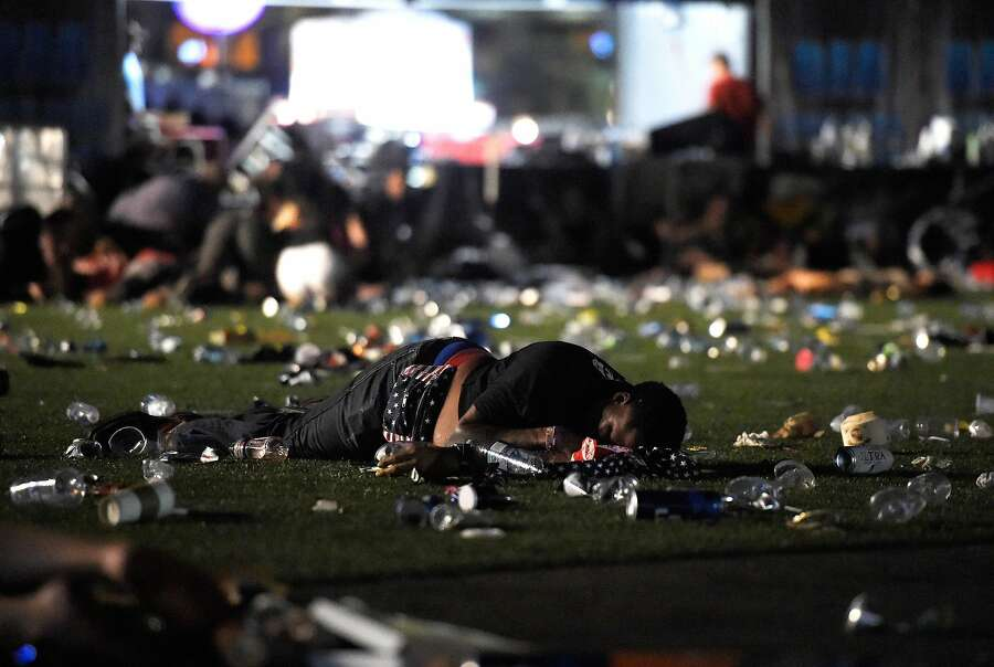 A person lies on the ground at the Route 91 Harvest country music festival after gun fire was heard on October 1st, 2017, in Las Vegas, Nevada. — Photograph: David Becker/Getty Images.