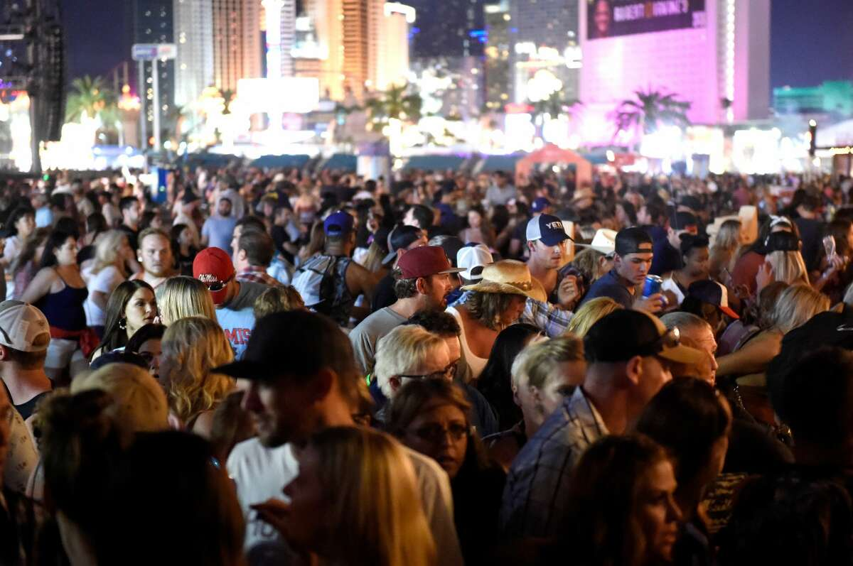 A crowd of people at the Route 91 Harvest country music festival after apparent gun fire was heard on October 1, 2017 in Las Vegas, Nevada. There are reports of an active shooter around the Mandalay Bay Resort and Casino. (Photo by David Becker/Getty Images)