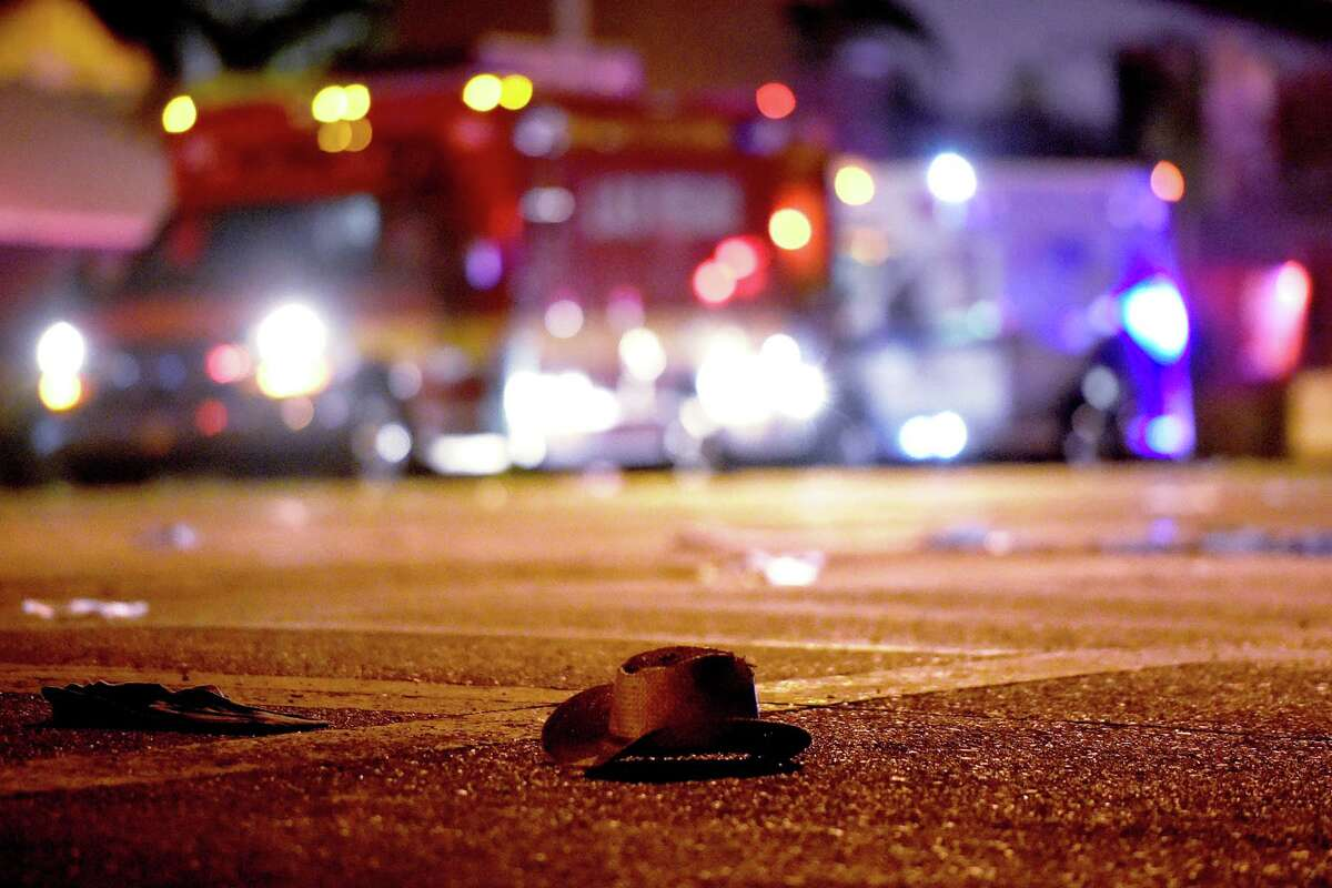 A cowboy hat lays in the street after a mass shooting at a Las Vegas concert that left dozens dead and hundreds injured. EDITOR'S NOTE: This slideshow contains images that may not be appropriate for all readers