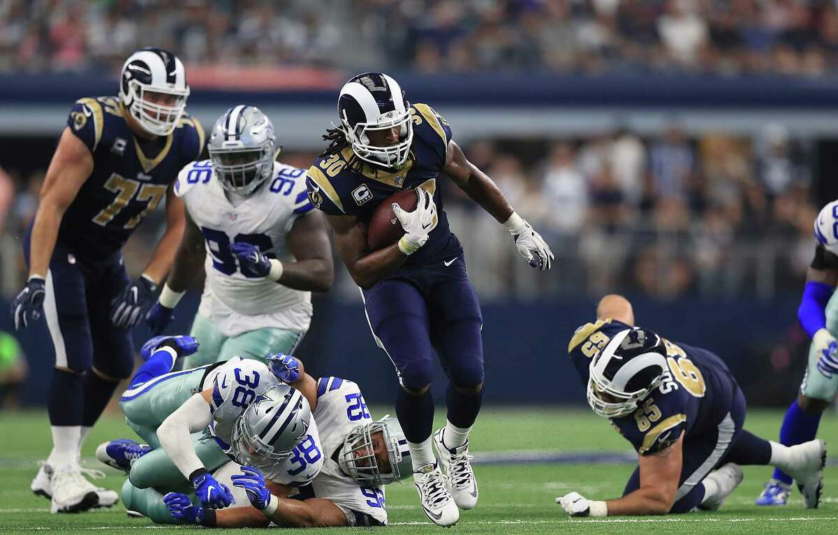 ARLINGTON, TX - OCTOBER 01: Todd Gurley #30 of the Los Angeles Rams runs the ball past Jeff Heath #38 and Brian Price #92 of the Dallas Cowboys in the third quarter at AT&T Stadium on October 1, 2017 in Arlington, Texas. (Photo by Ronald Martinez/Getty Images) ORG XMIT: 700070651