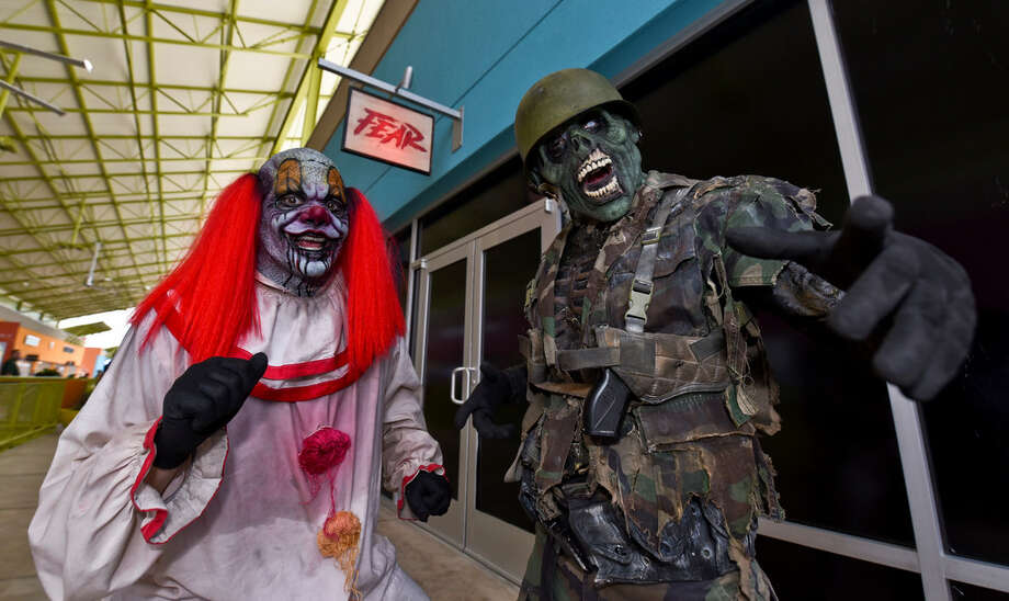 Characters inside FEAR Haunted House scare members of the media on Thursday, Sept. 28, 2017 during a media night for the attraction at The Outlet Shoppes at Laredo. Photo: Danny Zaragoza/Laredo Morning Times