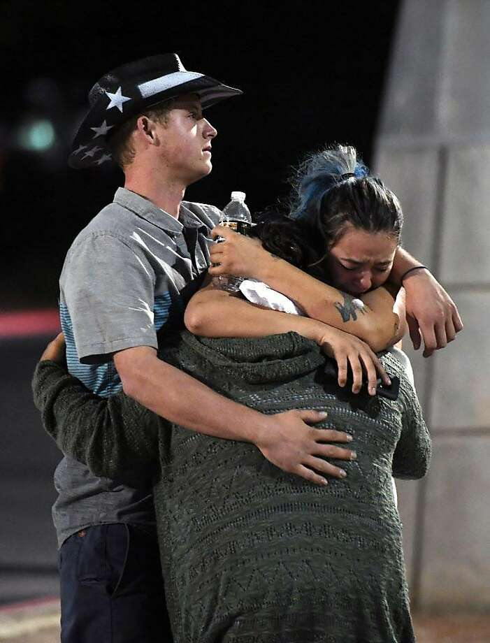 People hug and cry outside the Thomas & Mack Center after a mass shooting at the Route 91 Harvest country music festival on October 2, 2017 in Las Vegas, Nevada. A gunman, identified as Stephen Paddock, 64, of Mesquite, Nevada, opened fire from the Mandalay Bay Resort and Casino on the music festival, leaving at least 50 people dead and hundreds injured. Photo: Ethan Miller, Getty Images