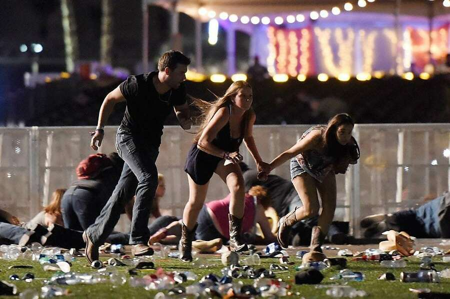 People run from the Route 91 Harvest country music festival after gun fire was heard on October 1st, 2017, in Las Vegas, Nevada. A gunman opened fire on a music festival in Las Vegas, leaving at least 59 people dead and more than 500 injured. — Photograph: David Becker/Getty Images.