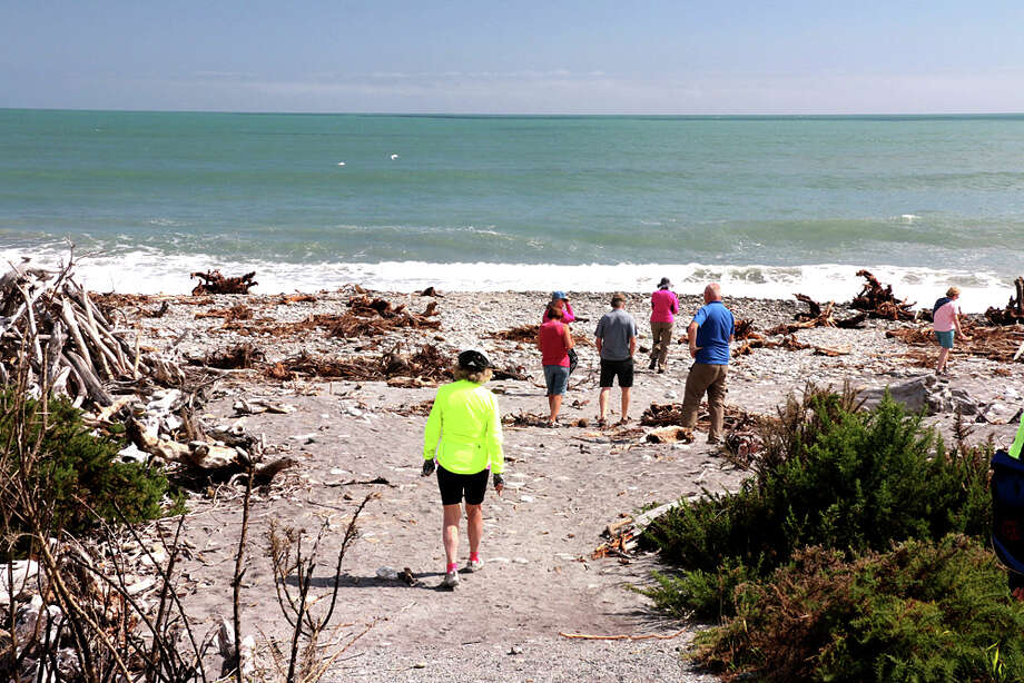 Cyclists take a break at a remote beach on New Zealand's West Coast. Great Bike Tours, a Vermont-based company, tailored the ride to all levels of experience. Photo: Simon Burrows, Great Bike Tours. / Simon Burrows, Great Bike Tours