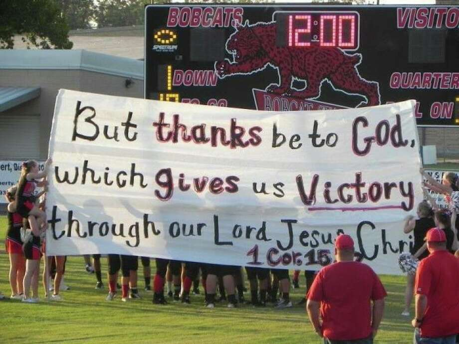Signs created by the Kountze High School cheerleaders for the football team. The cheerleaders have been told they cannot make signs with scripture on them. Photo: Provided
