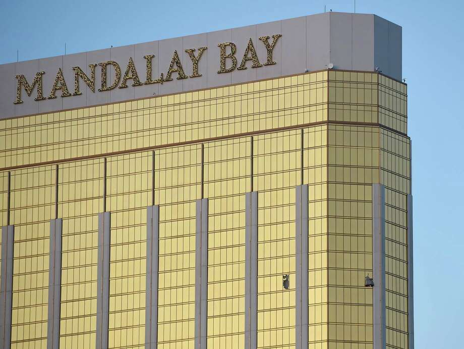 LAS VEGAS, NV - OCTOBER 02:  Broken windows are seen on the 32nd floor of the Mandalay Bay Resort and Casino after a lone gunman opened fired on the Route 91 Harvest country music festival on October 2, 2017 in Las Vegas, Nevada. The gunman, identified as Stephen Paddock, 64, of Mesquite, Nevada, opened fire from the Mandalay Bay Resort and Casino on the music festival, leaving at least 50 people dead and hundreds injured. Police have confirmed that one suspect has been shot. The investigation is ongoing.   (Photo by David Becker/Getty Images) Photo: David Becker/Getty Images