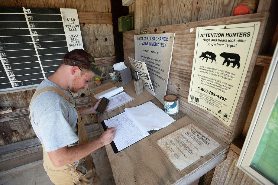 Brian Curtis signs out before leaving Forest Lake Hunting Club on Thursday. Curtis traveled to the site to drop off repair materials for flood damage restoration. Curtis noted that he is one of several area hunters behind schedule in season preparation due to Tropical Storm Harvey.     Photo taken Thursday, September 28, 2017 Guiseppe Barranco/The Enterprise Photo: Guiseppe Barranco, Photo Editor / Guiseppe Barranco ©