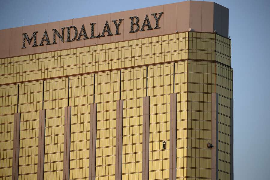 Drapes billow out of broken windows at the Mandalay Bay resort and casino Monday, October 2nd, 2017, on the Las Vegas Strip following a deadly shooting at a music festival in Las Vegas. A gunman was found dead inside a hotel room. — Photograph: John Locher/Associated Press.