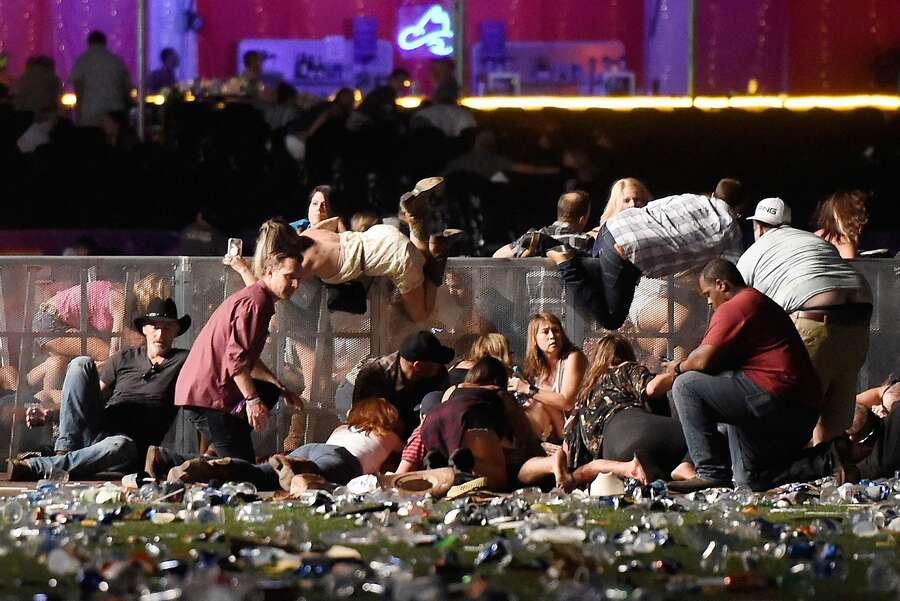 People scramble for shelter at the Route 91 Harvest country music festival after gun fire was heard on October 1st, 2017, in Las Vegas, Nevada. — Photograph: David Becker/Getty Images.