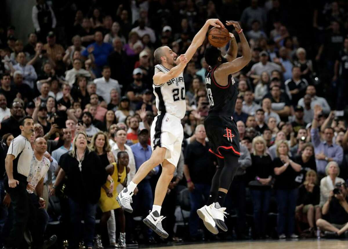 Manu Ginobili blocks Houston Rockets' James Harden 3-point shot in the final seconds of overtime of Game 5 in a second-round playoff series May 9, 2017, in San Antonio. The Spurs won 110-107.