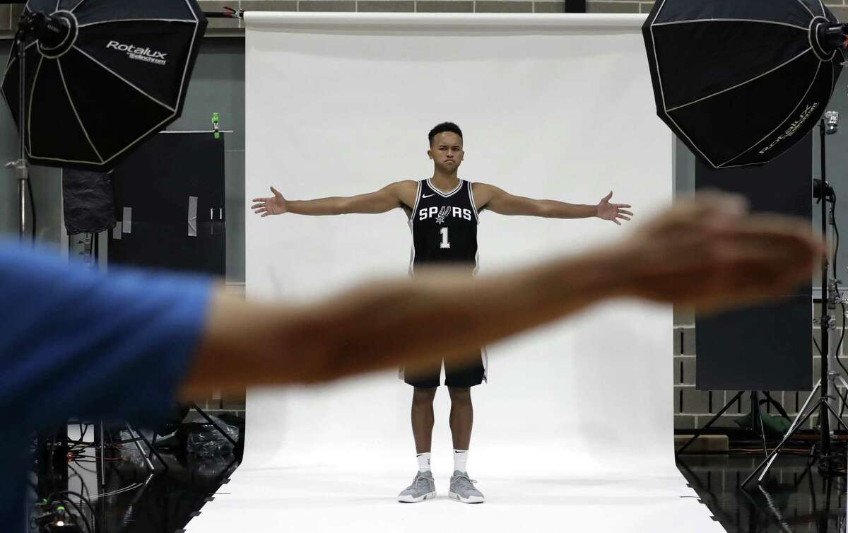 San Antonio Spurs forward Kyle Anderson (1) is given directions as he poses for photos on media day at the team's practice facility, Monday, Sept. 25, 2017, in San Antonio.