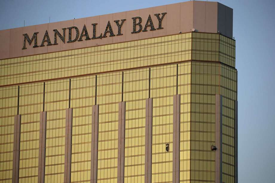 Drapes billow out of broken windows at the Mandalay Bay resort and casino Monday, Oct. 2, 2017, on the Las Vegas Strip following a deadly shooting at a music festival in Las Vegas. A gunman was found dead inside a hotel room. Photo: John Locher /Associated Press / Copyright 2017 The Associated Press. All rights reserved.