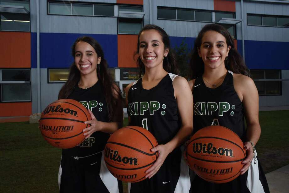 Triplets Alyssa, left, Breanna and Cierra Cadena are senior multisport athletes at KIPP Academy high school. Photo: Billy Calzada /San Antonio Express-News / San Antonio Express-News