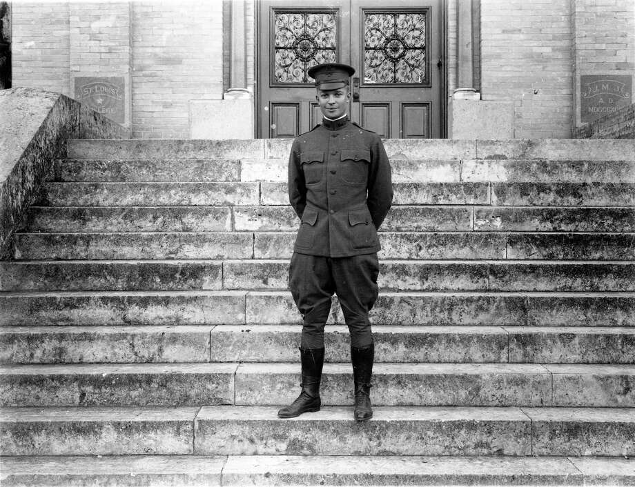Dwight D. Eisenhower poses in 1916 on the steps of St. Louis College in San Antonio, later known as St. Mary's University. Eisenhower coached a football team at St. Louis College during his early years as a military officer at Fort Sam Houston. Photo: Courtesy Eisenhower Presidential Library And Museum