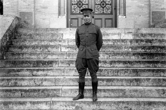Dwight D. Eisenhower poses in 1916 on the steps of St. Louis College in San Antonio, later known as St. Mary's University. Eisenhower coached a football team at St. Louis College during his early years as a military officer at Fort Sam Houston.
