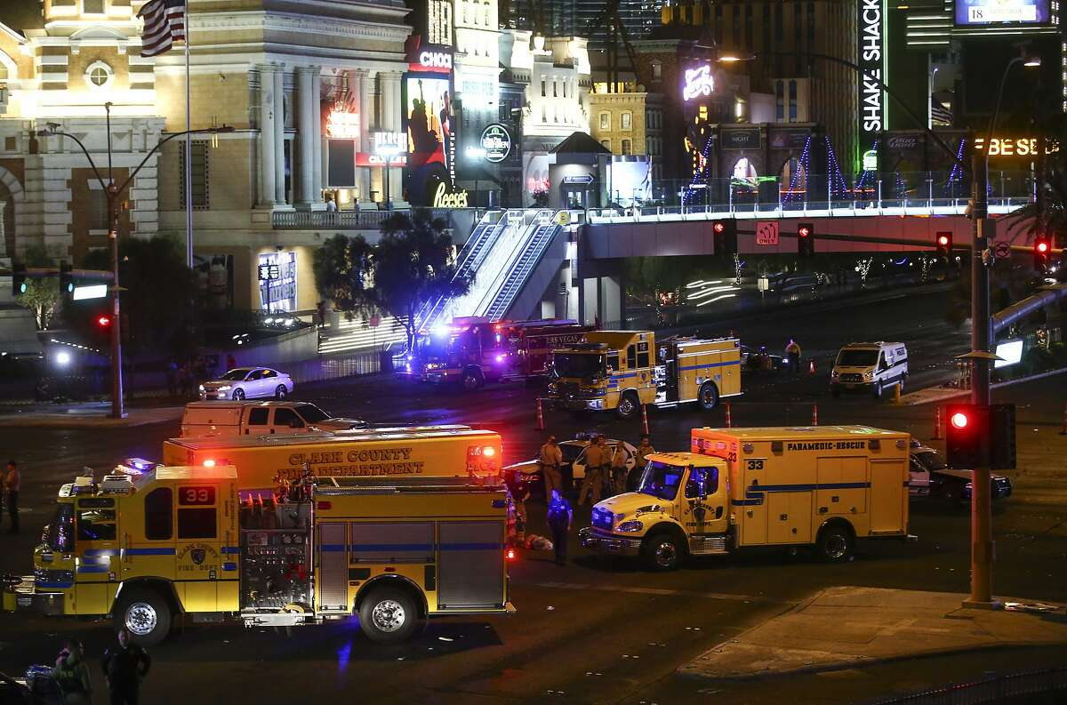 Las Vegas police and emergency vehicles sit on scene following a deadly shooting at a music festival on the Las Vegas Strip early Monday, Oct. 2, 2017.