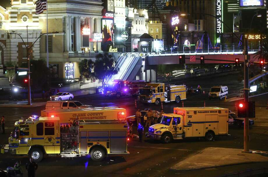 Las Vegas police and emergency vehicles sit on scene following a deadly shooting at a music festival on the Las Vegas Strip early Monday. Photo: Chase Stevens /Associated Press / Las Vegas Review-Journal