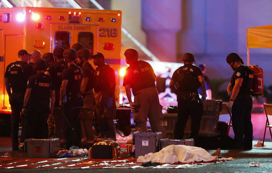 A body is covered with a sheet after a mass shooting in which dozens were killed at a music festival on the Las Vegas Strip on Sunday, Oct. 1, 2017. (Steve Marcus/Las Vegas Sun via AP) Photo: Steve Marcus, Associated Press