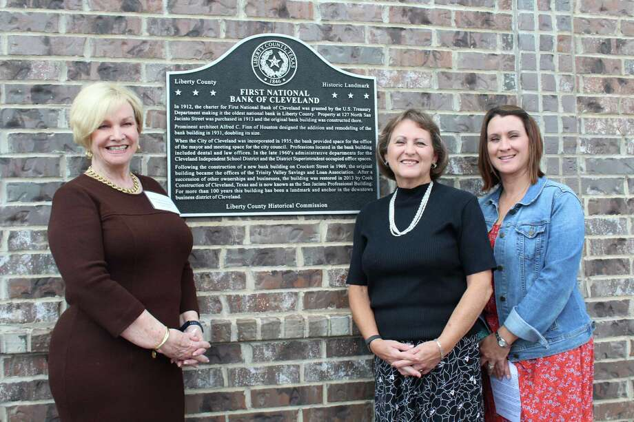 A historical marker was commissioned Thursday at the San Jacinto Professional Building, former home of First National Bank of Cleveland. The building is owned by Sherry Cook and daughter, Lori Cook Smith, pictured center and right, respectively. They are pictured with Linda Jamison, county chair of the Liberty County Historical Commission. Photo: Vanesa Brashier