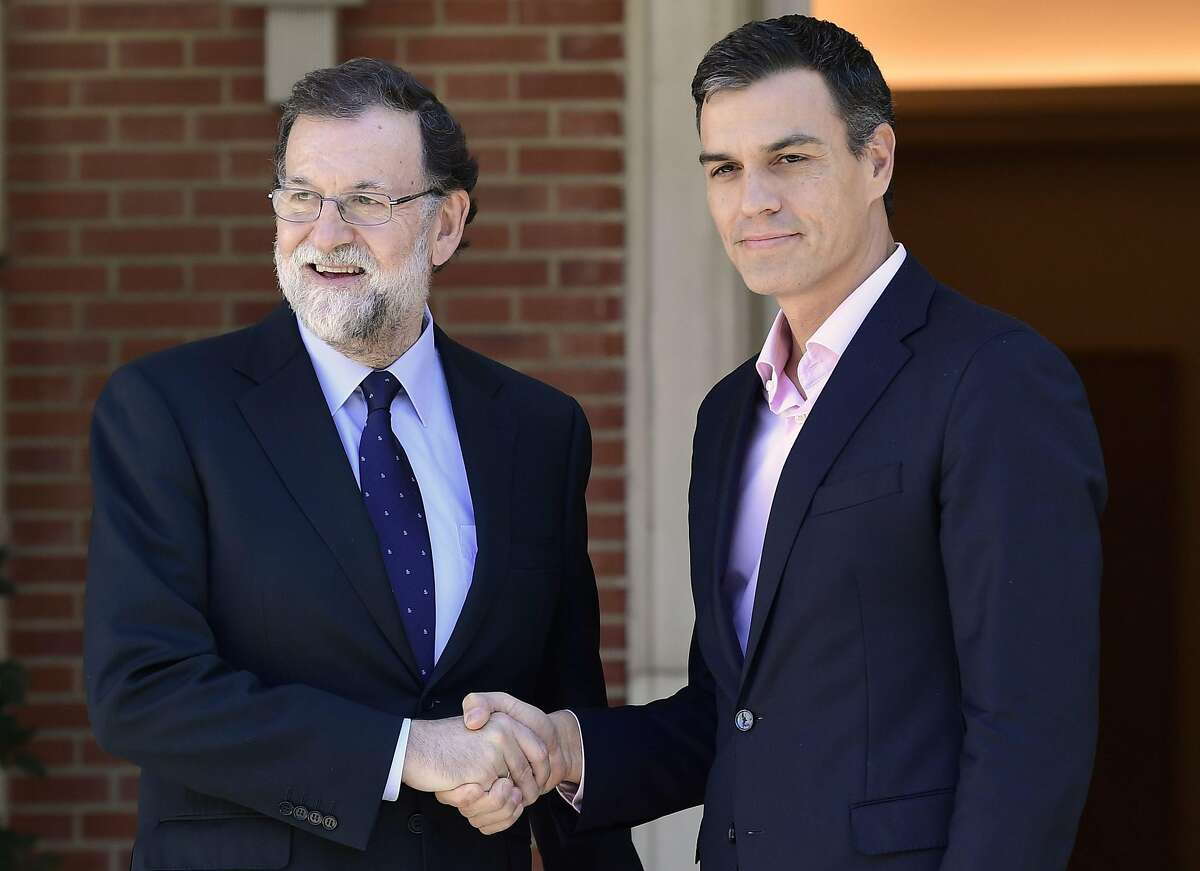Spanish Prime Minister Mariano Rajoy (left) shakes hands with Spanish Socialist Party PSOE leader Pedro Sanchez prior to holding a meeting at La Moncloa palace in Madrid on October 2, 2017. Spain came under international pressure today to resolve a spiralling crisis with its Catalan region after a banned independence referendum was marred by shocking scenes of police violence. / AFP PHOTO / JAVIER SORIANOJAVIER SORIANO/AFP/Getty Images