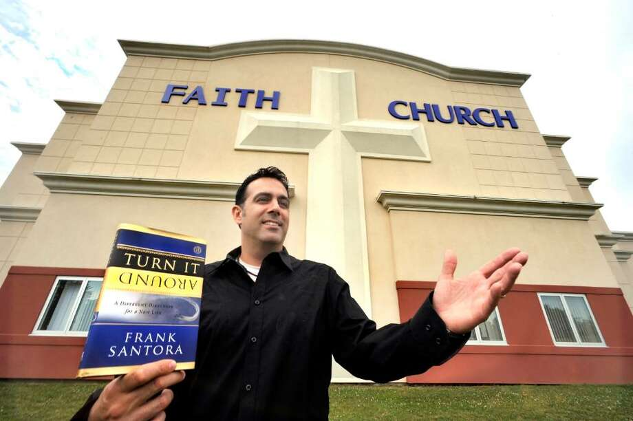 "Frank Santora, pastor of Faith Church in New Milford, talks about his book, ""Turn it Around"", outside the church on Thursday, June 24, 2010. Photo: Michael Duffy / The News-Times"