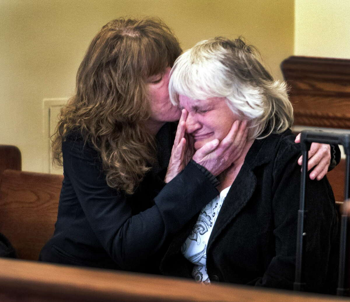 Linda Wright, sister of Richard J. Wright, and his mother Linda Wright react to the news that their brother and son who was sentenced for arson and double homicide 30 years ago was granted a retrial as a result of new evidence by Judge Andrew Ceresia Monday Oct. 2, 2017 in Troy, N.Y. (Skip Dickstein/Times Union)