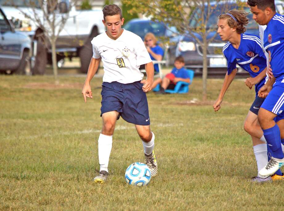 Father McGivney junior Aaron Boulanger controls the ball during the first half of Friday's home game against Roxana.