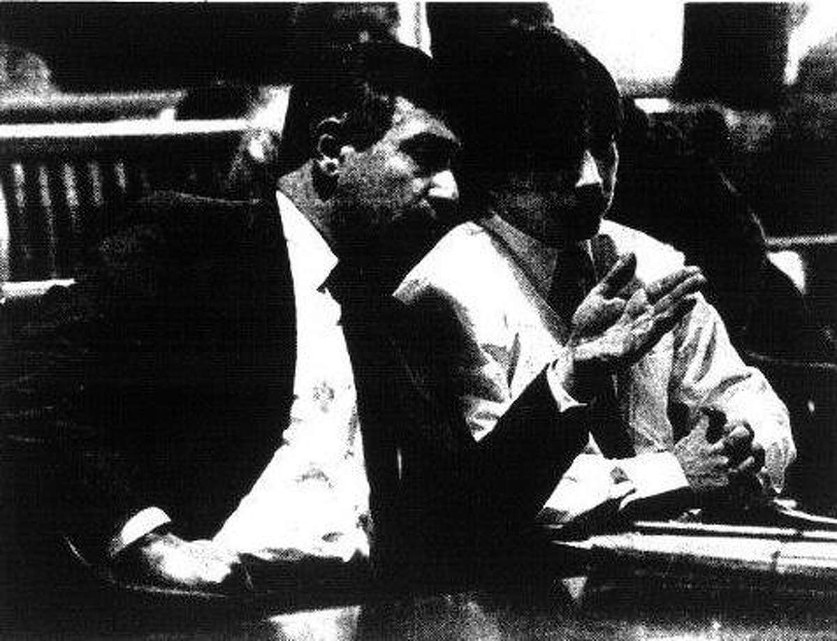 Attorney William Dreyer confers with Wright during the teenager's 1988 trial, which ended with his conviction on arson and murder charges. (Times Union archive)