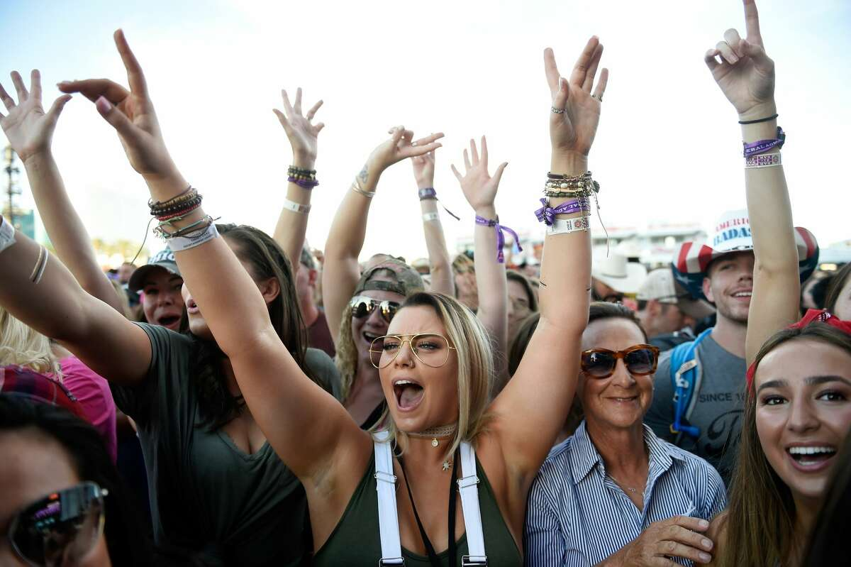 Fans cheer during the Route 91 Harvest country music festival at the Las Vegas Village on September 29, 2017 in Las Vegas, Nevada.
