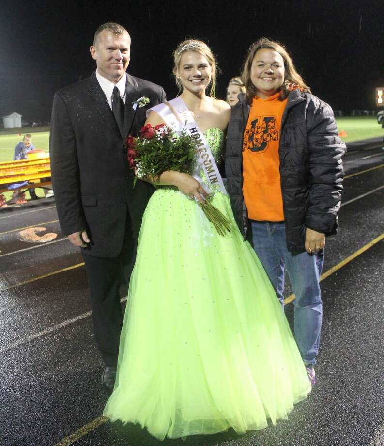 Kara Peruski, a senior at Ubly High School, was crowned this year's homecoming queen during Friday night's football game. She is pictured here with her parents, Skatch and Tammy Peruski. Photo: Submitted Photo
