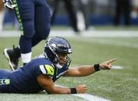 SEATTLE, WA - OCTOBER 1: Quarterback Russell Wilson #3 of the Seattle Seahawks argues against the safety, but the play call is challenged by the Indianapolis Colts and the Colts are given a safety in the first quarter of the game at CenturyLink Field on October 1, 2017 in Seattle, Washington. (Photo by Otto Greule Jr/Getty Images)
