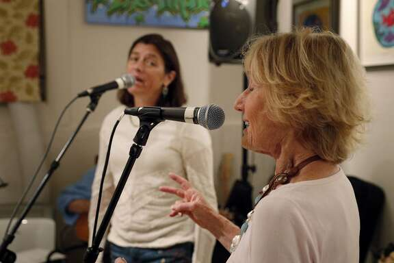 Nancy Bechtle, right, and Tricia Hellman Gibbs, left, during practice for Nancy's group Nancy and the Lambchops at Mick Hellman's home in San Francisco, Calif., on Tuesday, September 19, 2017. Bechtle is Warren Hellman's sister, and the group will be performing at Hardly Strictly Bluegrass music festival in October.