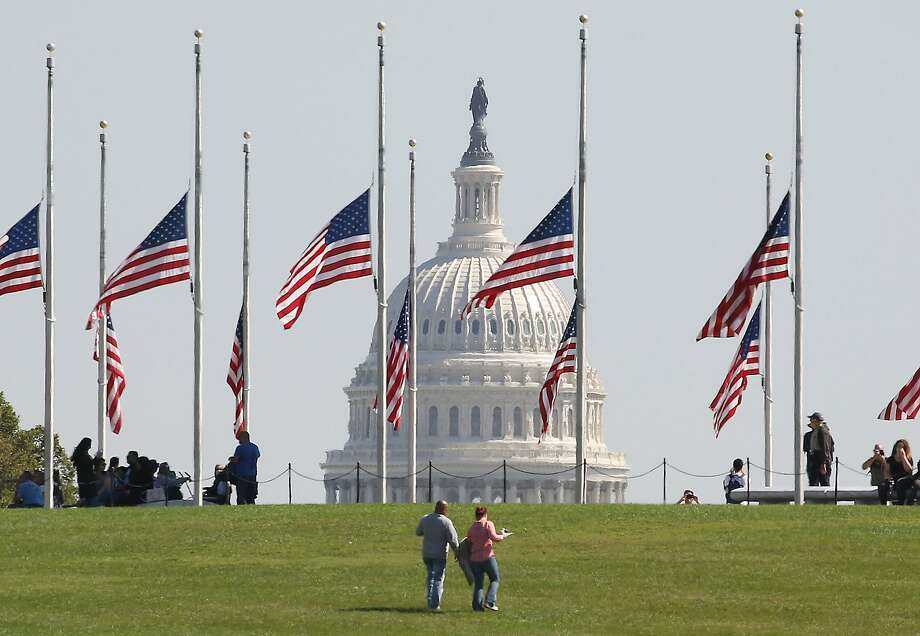 U.S. flags on the grounds of the Washington Monument are lowered to half-staff, on October 2, 2017 in Washington, DC. President Donald Trump ordered the flags on all federal buildings to fly at half-staff following the mass shooting that left more than 50 dead in Las Vegas Photo: Mark Wilson, Getty Images