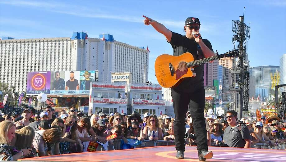 "This photo shows singer Josh Abbott of the Texas-based Josh Abbott Band performing during the Route 91 Harvest country music festival in Las Vegas hours before a gunman opened fire on the crowd. Guitarist Caleb Keeter said the massacre changed his views on gun control: ""I've been a proponent of the 2nd amendment my entire life. Until the events of last night,"" Keeter said on Twitter.Click ahead to see how politicians and celebrities reacted to the Las Vegas shooting. Photo: Mindy Small/FilmMagic"