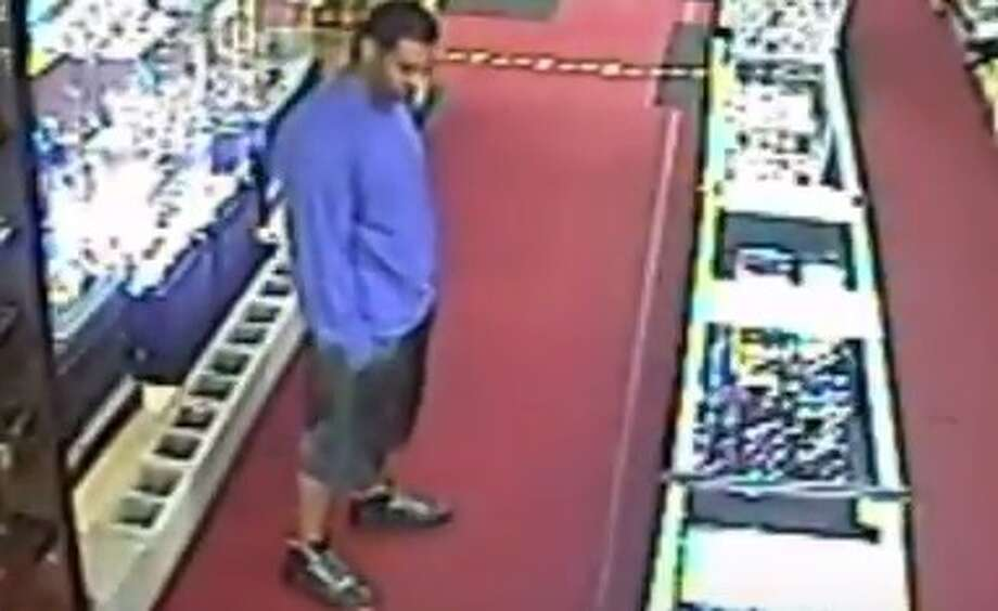 The suspect in this photo is wanted by Houston police in three robberies of two smoke shops, located at 10875 Katy Freeway and 1726 S. Dairy Ashford. The robberies took place at the Katy Freeway smoke shop on Aug. 25 and Sept. 22 and at the Dairy Ashford location on Sept. 18. Photo: Houston Police Robbery Division