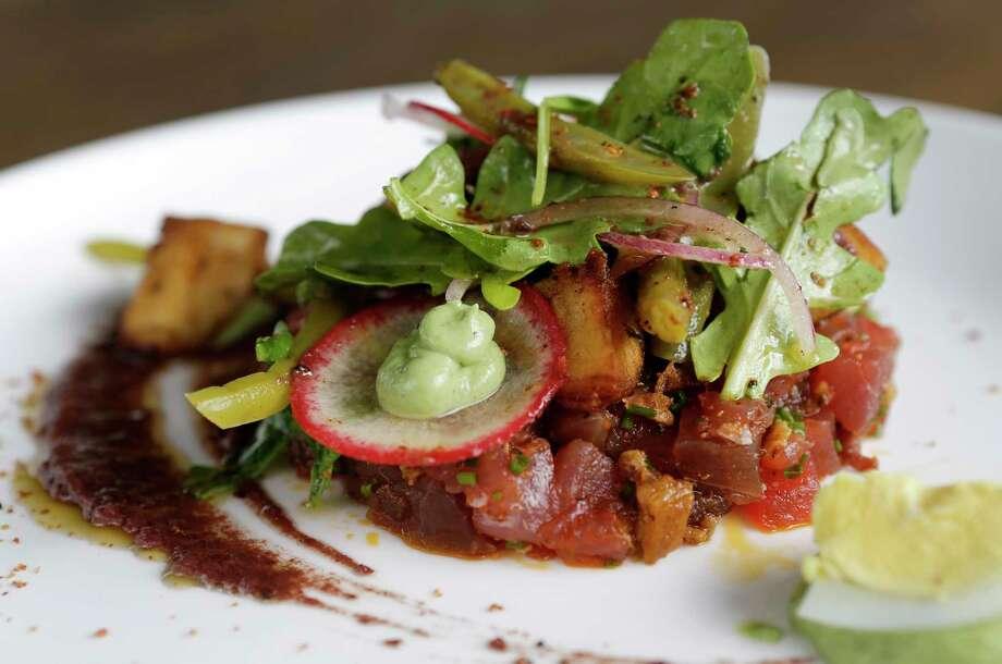 Spicy tuna nicoise salad is on the new lunch menu at Killen's STQ. Photo: Melissa Phillip, Houston Chronicle / © 2017 Houston Chronicle
