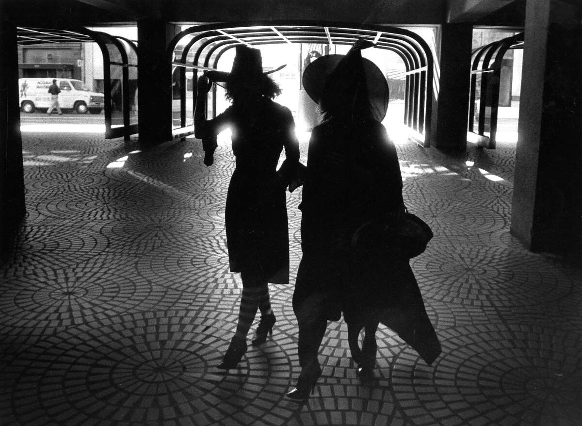 Adults in costume for various Halloween events .. A couple workers with their witch hats return to work at the Embarcadero Center, 10/31/1989