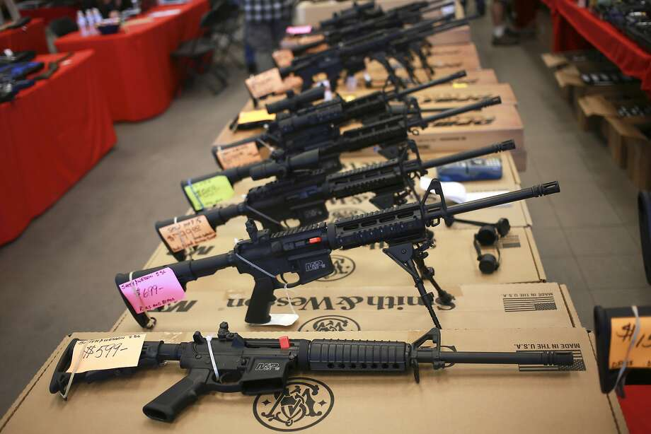 Smith & Wesson AR-15 rifles for sale at a gun show in Loveland, Colo. in 2014. Shares of Smith & Wesson's parent company, American Outdoor Brands, rose in Monday's trading. Photo: LUKE SHARRETT, NYT