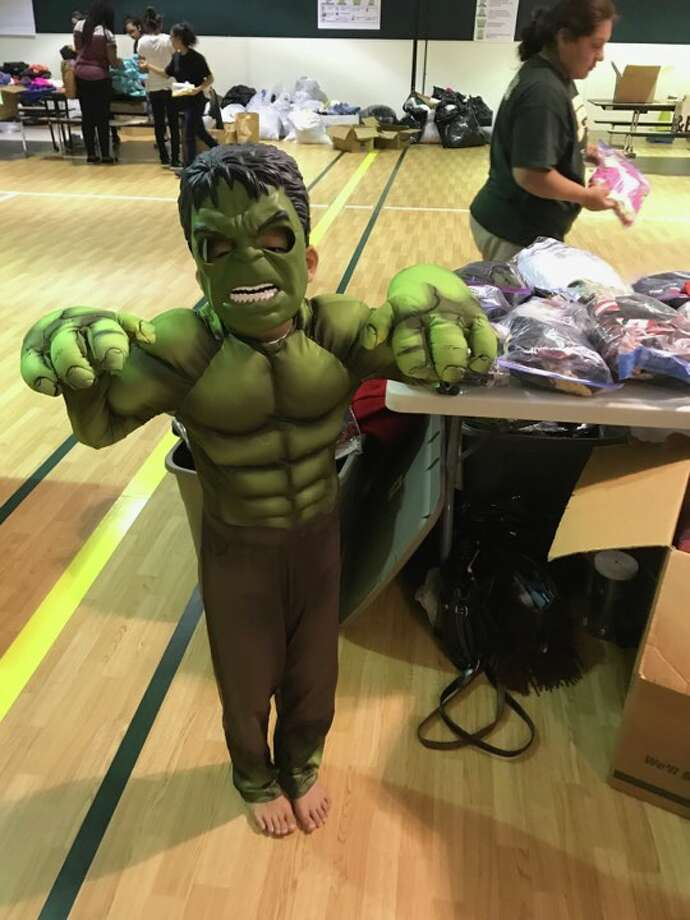 A child tries on a donated costume on Saturday, Sept. 30 at a costume giveaway organized for Hurricane Harvey victims by two Katy-area moms. Photo: Courtesy: Becky Schmidt