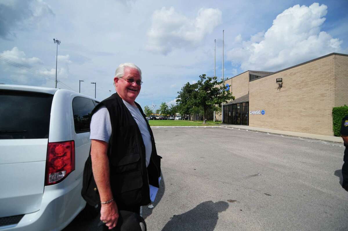 Ben Hodges, 70, collects his safe-deposit box belongings from a Chase collection center north of Houston after his bank branch was flooded during Hurricane Harvey. The Friendswood resident has been storing documents, such as real estate agreements and car titles, inside a safe-deposit box since 1967 and doesn't plan to change after Harvey flooded thousands of boxes.