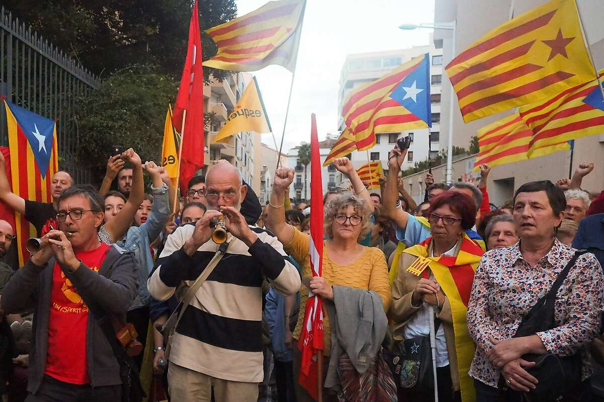 Demonstrators rally in Perpignan, Spain, against police violence during the independence vote.