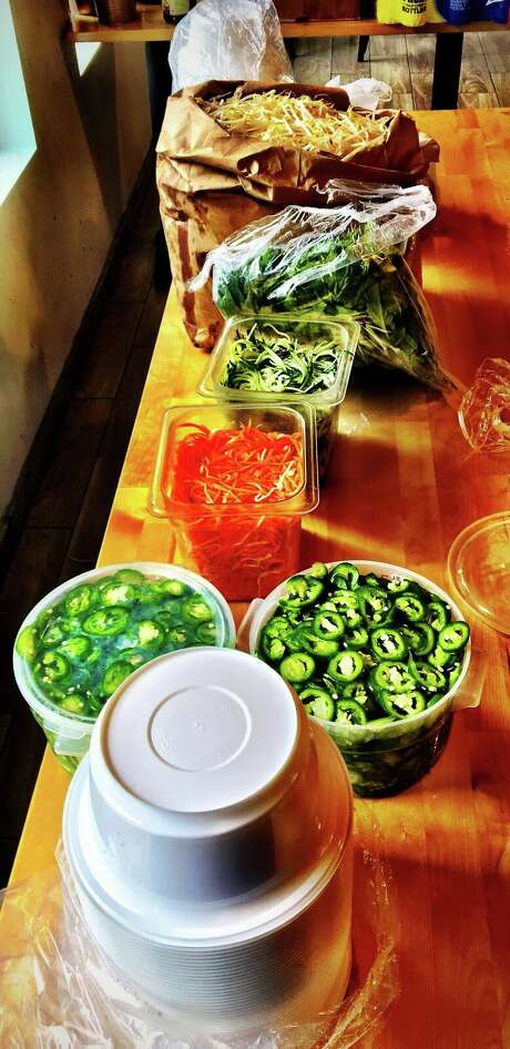 Mung bean sprouts, Thai basil, sliced jalapeños and shredded carrots and cucumbers for pho prepped at Les Ba'get. Photo: David Leftwich