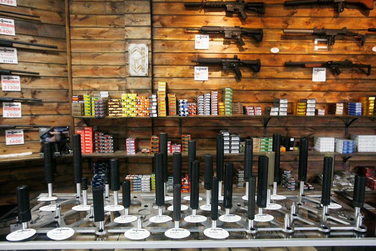 Suppressors, ammunition and firearms on display Thursday, Dec. 10, 2015, at SK Arms. James Durbin/Reporter-Telegram
