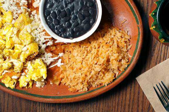Egg chilaquiles with beans, rice, and  coffee at El Buen Comer on Wednesday, September 27, 2017, in San Francisco, Calif.
